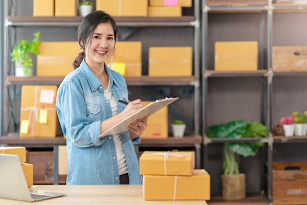 Business owner handling shipping tasks after choosing between FreightDesk Online vs. ShipRush-1