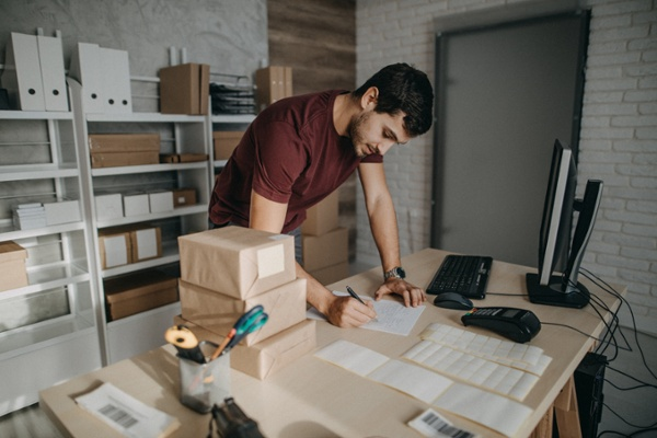 Ecommerce business owner organizing packages for shipment