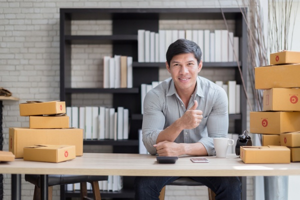 Entrepreneur managing the shipping component of his e-commerce business