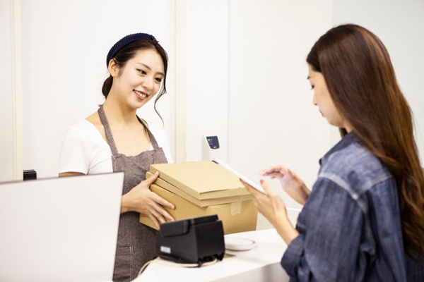 Recipient picking up a package from a retail location
